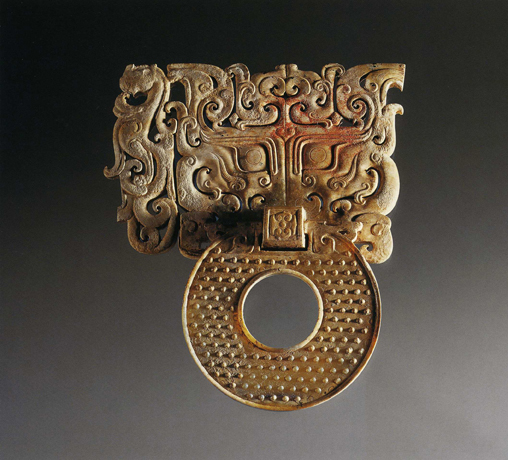 Jade ornament with an animal mask